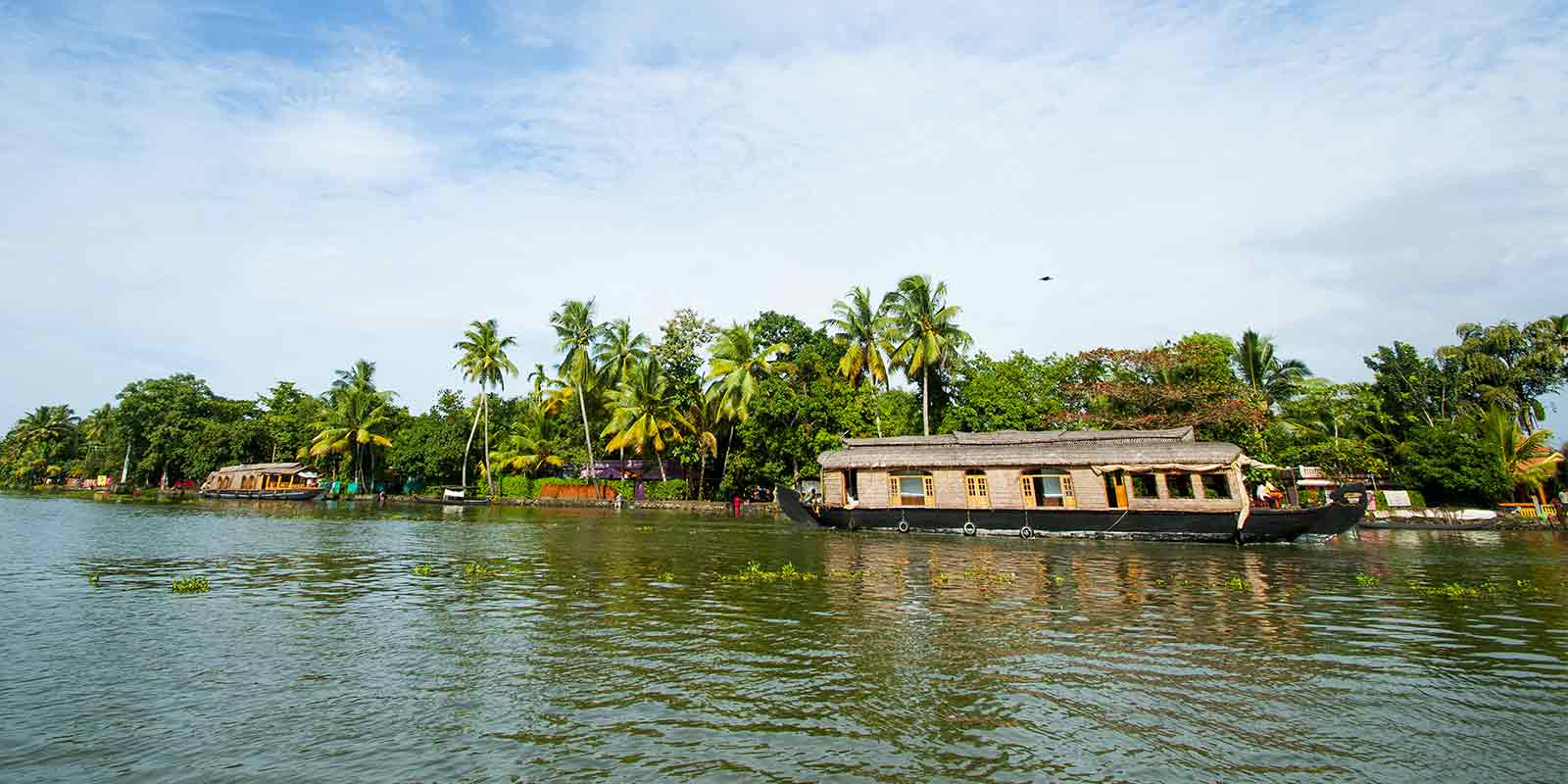 Traditional houseboat on the backwaters in Kerala, India