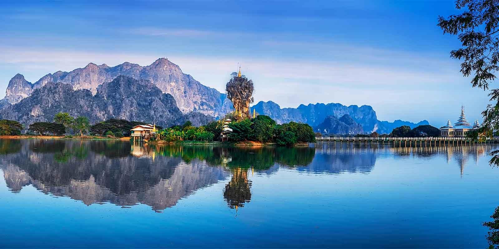 Kyauk Kalap Pagoda and reflection over lake