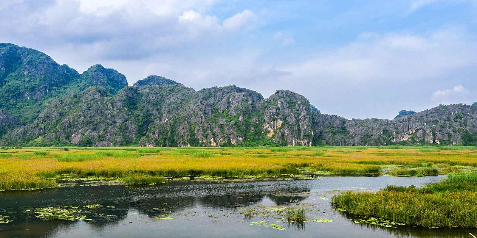 Mountain and lake scenery at Van Long Nature Reserve in Vietnam