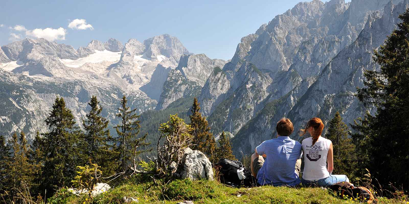 Couple of hikers resting in Dachstein Mountains in Austrian Alps