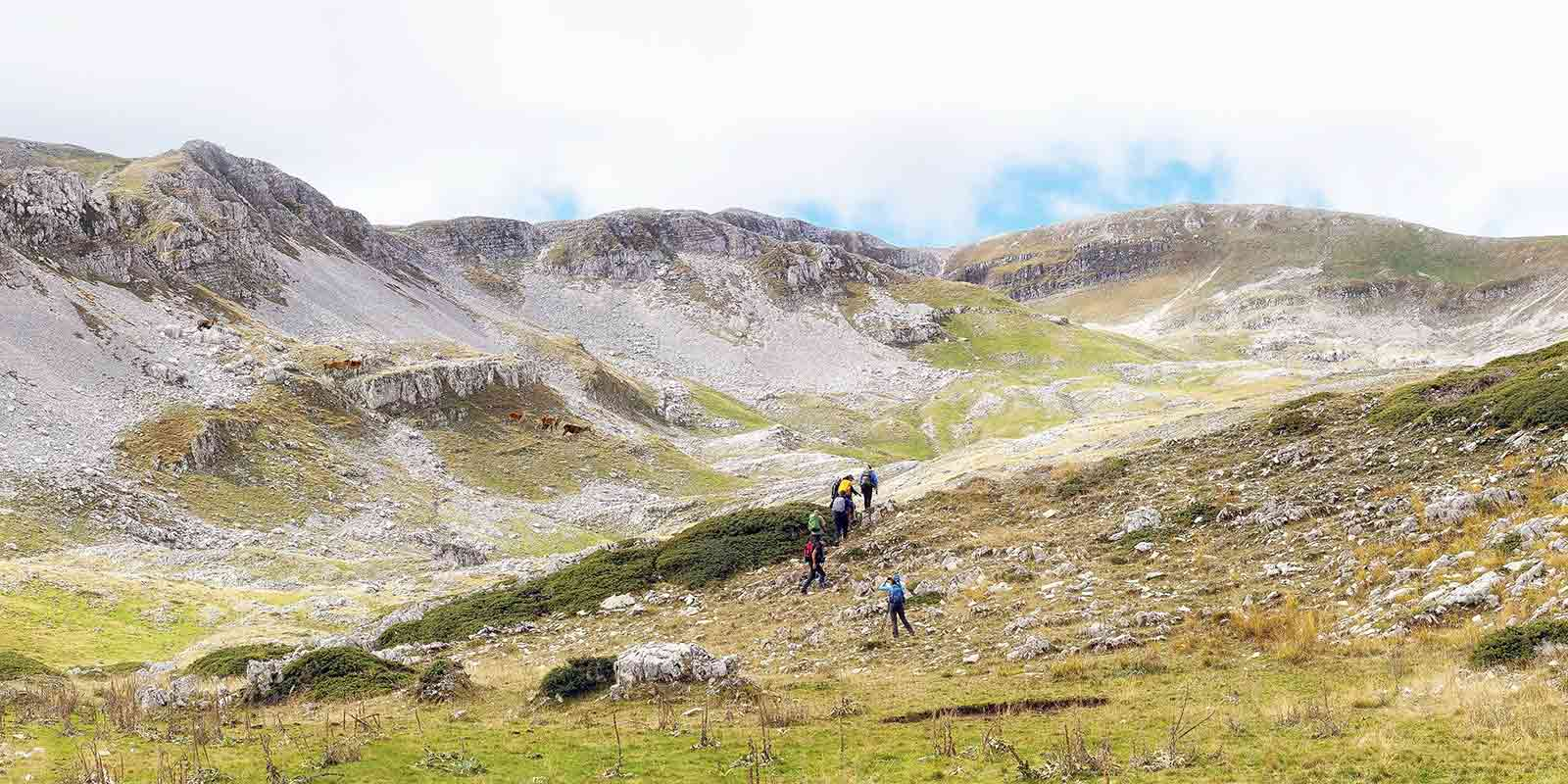 Hikers walking in a valley in the Abruzzo region of Italy