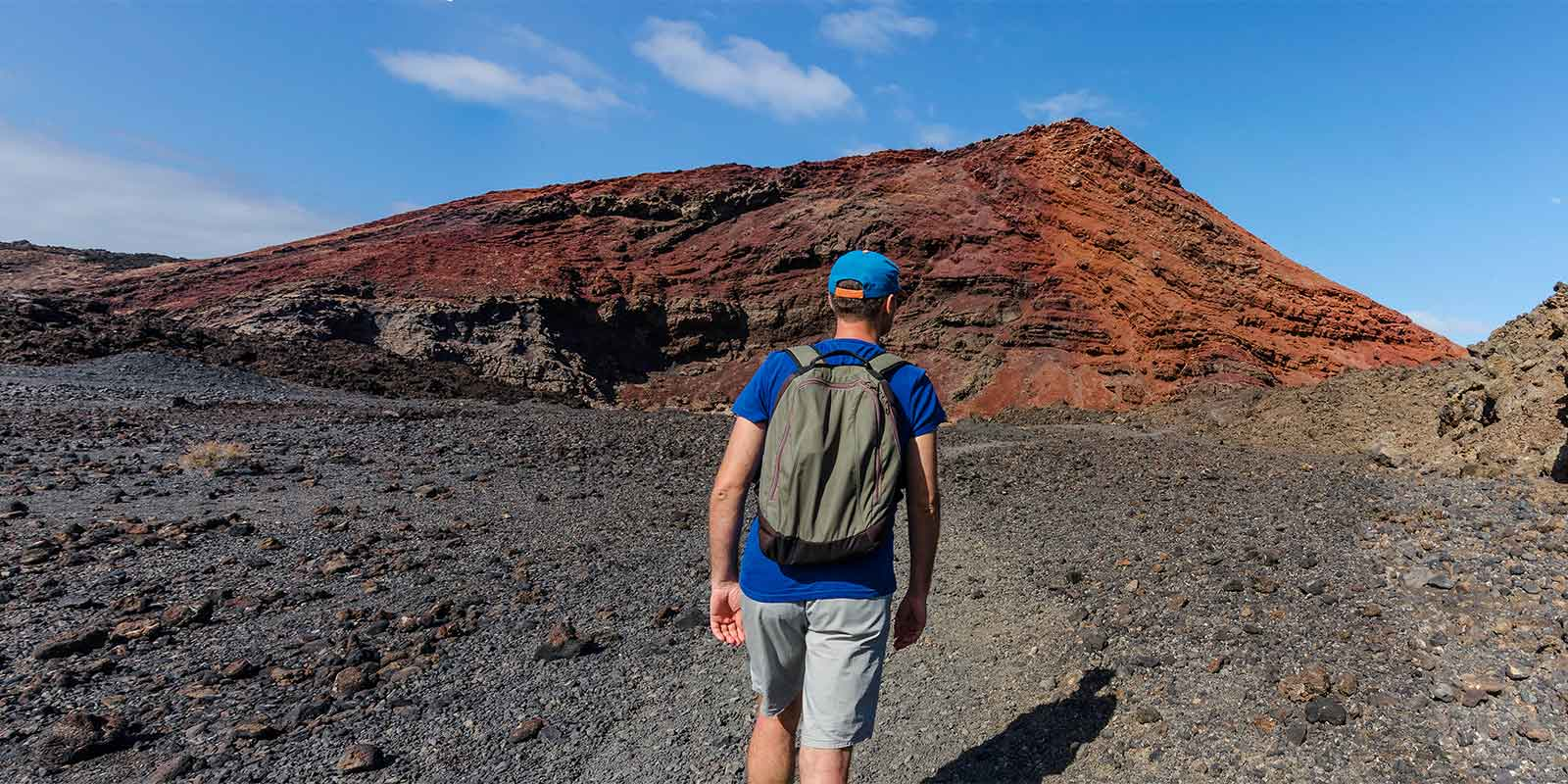 Hiker in Timanfaya National Park in Lanzarote in the Canary Islands