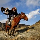 Eagle hunter on horseback, Kyrgyzstan