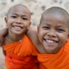 Young monks smiling at camera