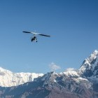 Microflight in Annapurna range with Machapuchare summit in Himalayas Nepal