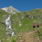 Two hikers ascending mountain at Hohe Tauern in the Austrian Alps