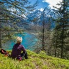 Hiker resting in mountains of Austrian Alps