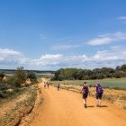 Hikers on country track on French Way of Camino de Santiago