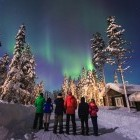 Group of hikers enjoying the Northern Lights in Laplan