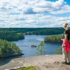 Hiker admiring lake view in Finland