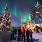 Group of hikers enjoying the Northern Lights Aurora Borealis
