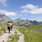 Hikers approaching Midi d'Ossau in the French Pyrenees