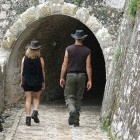 Two hikers in a town or village on the Greek island of Corfu