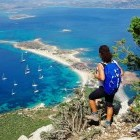 Hiker admiring the view over bay in Tavolara in Sardinia