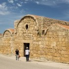 Hikers outside an ancient church on the Sinis Loop