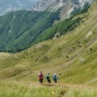 Hikers walking through a mountain valley in Montenegro