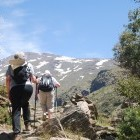 Hikers on the GR7 trail in the Sierra Nevada mountains