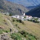 Hiking towards a village on the GR7 trail in Sierra Nevada