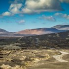 Hiker walking through typical scenery in Lanzarote in the Canary Islands