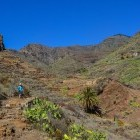Hiker heading into mountains on the Island of Gomera in the Canary Islands