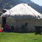 Nomads in yurt, Kyrgyzstan
