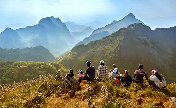 Group of trekkers resting at Doi Luang mountain at Chiang Dao near Chiang Mai