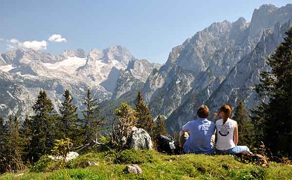 Trekkers resting in Dachstein mountains in Austrian Alps