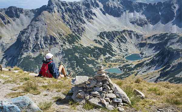 Hiker resting at Musala Peak in Rila Mountains Bulgaria