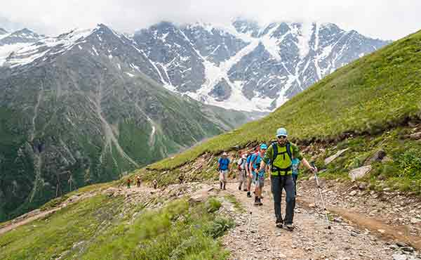 Group of trekkers in the Caucasus mountains in Georgia