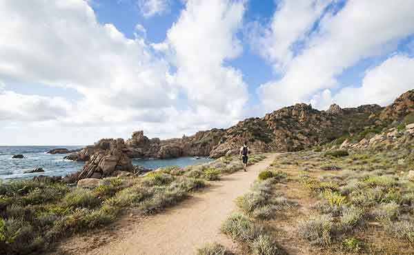 Hiker on coastal trail in Sardinia