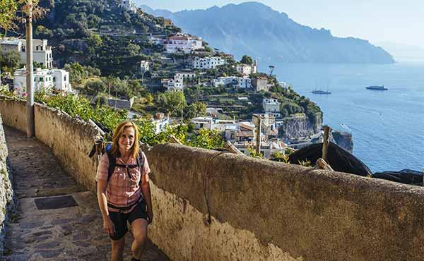 Hiker following the Amalfi coastal path