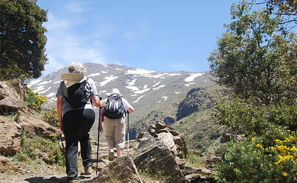 Hikers on the GR7 in Sierra Nevada mountains